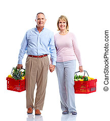 Grocery. Couple with a shopping basket. - Grocery. Happy...