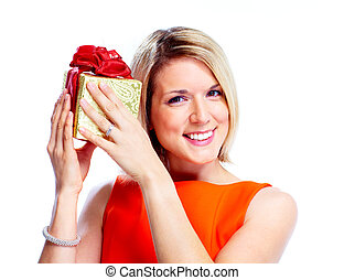 Happy woman with christmas gift. - Beautiful smiling girl...
