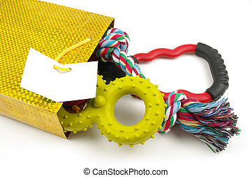 dog toys in a bag - dog toys in a gold bag with white label...