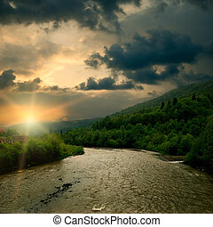 Sunrise on mountain river. Rural landscape