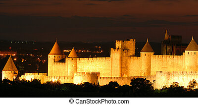 Carcassone at Night - The illuminated walls and towers of...