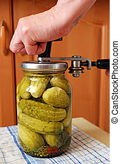 cucumbers in glass jar - preserving of cucumbers in glass...