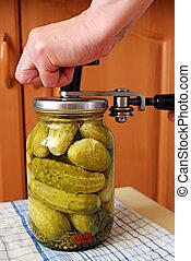 cucumbers in glass jar - preserving of cucumbers in glass...