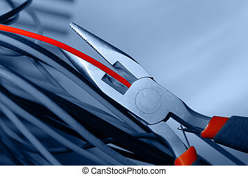 pliers and red cable  - pliers cut the red cable
