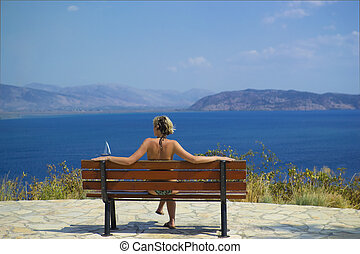 girl in a bench by the sea