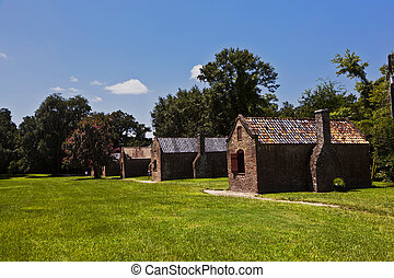 old slave huts in a South Carolina farm - old slave huts in...