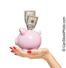 piggy bank with money on woman hand isolated over white