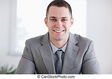 Close up of smiling businessman - Close up of smiling young...