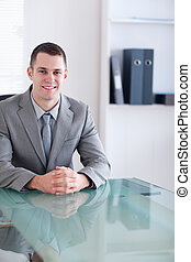 Close up of businessman sitting behind a table