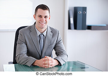 Smiling businessman in a meeting - Smiling businessman...