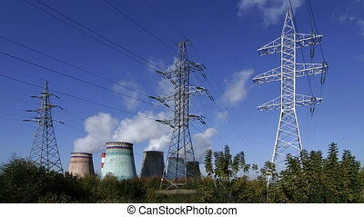 power station, timelapse - high voltage power pylons on...