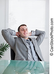 Close up of young businessman relaxing