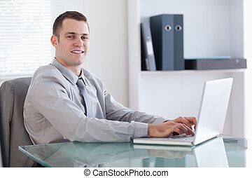 Young businessman using his notebook