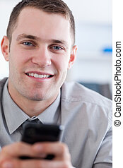 Close up of businessman with mobile phone in his hans