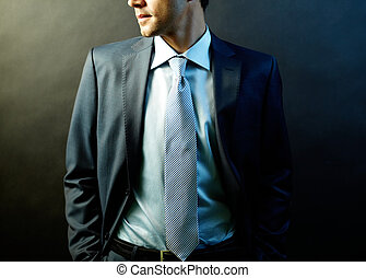 Business fashion - Figure of elegant businessman in suit...