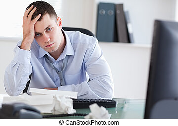 Close up of frustrated businessman doing his accounting -...