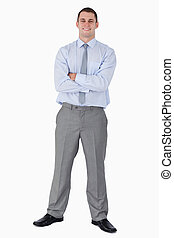 Happy businessman with his arms folded
