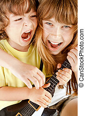 kids playing guitar singing