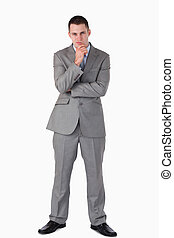 Young businessman in thoughts
