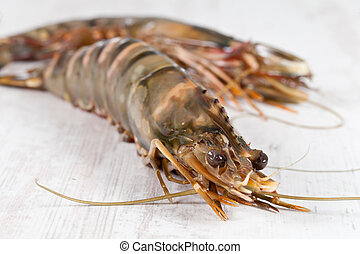 Gambas - Fresh raw big prawn on wooden background