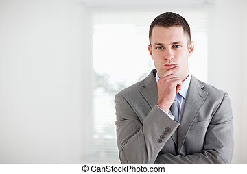 Businessman considering - Young businessman considering