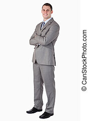 Smiling businessman with folded arms on white background