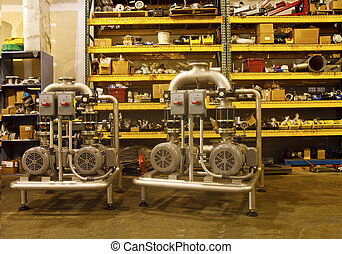 Industrial Equipment in a Warehouse - Large pieces of...