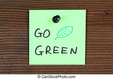Go green - Sticky note with environment message - go green....