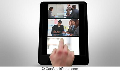Animated tablet computer showing business meeting scenes