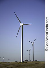 Wind farm in the midwest - Wind turbines in an open field in...