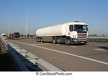 Petrol Truck on the Freeway - Truck carrying petrochemical...