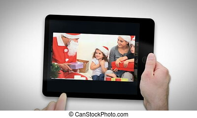 Animated tablet computer displaying videos about family at...