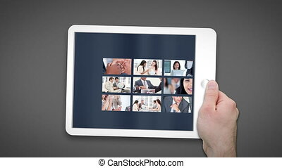 Animated tablet computer displaying videos about meetings in...