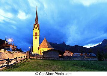 alpine church at evening