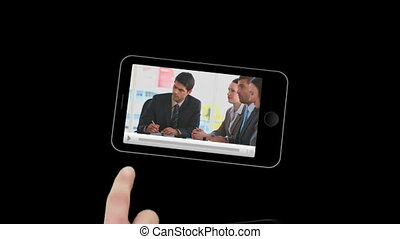 Smartphone showing business scenes against a black...