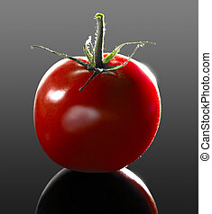 "perfect tomato - studio shot of a ""perfect"" tomato in dark..."