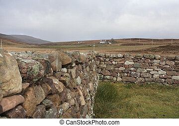 scottish stone wall in rural ambiance - peaceful scenery in...