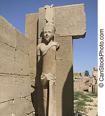 statue around Precinct of Amun-Re - ancient scenery with...