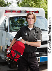 EMS Professional Woman with Oxygen Unit - Portrait of an EMS...