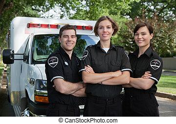 Emergency Medical Team Portrait - Group of three paramedics...