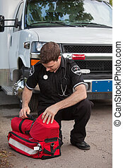 Male Paramedic with Oxygen Unit - Male emergency medical...