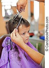 Barbershop blues - Boy in barbershop sad about loosing his...