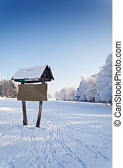 Winter scenery with hiking sign