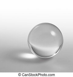 crystal ball - a clear crystal ball and light reflections in...