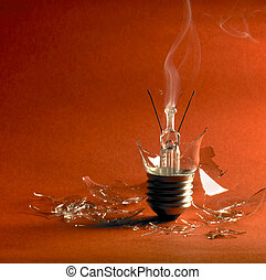 broken light bulb - broken upright light bulb with smoke and...
