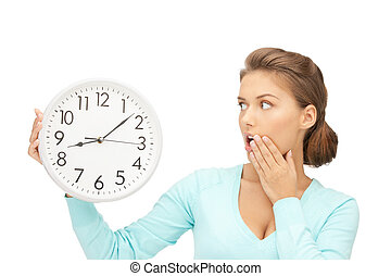 woman holding big clock - bright picture of woman holding...