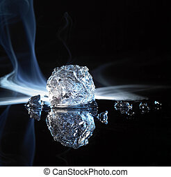 piece of ice - studio photography of a ice crystal and smoke...