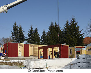 wooden house construction in sunny ambiance