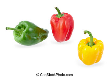 yellow, green and red peppers on a white background