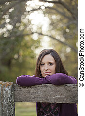 Serious Young Woman in Country - Young woman with serious...
